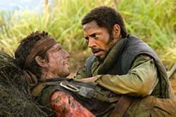 MARIE WEISMILLER WALLACE / DREAMWORKS - FALLEN COMRADE: Kirk Lazarus (Robert Downey Jr., right) tends to Tugg Speedman (Ben Stiller) in Tropic Thunder.