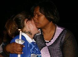 JASIATIC - FAMILY GRIEF: Darryl Turner's mother Tammy Fontenot hugs his girlfriend, Marie Ruta, at a candlelight vigil the family held last Thursday.