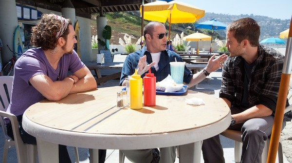 FAST FOOD: Corrupt DEA agent Dennis (John Travolta) wheels and deals with Ben (Aaron Johnson) and Chon (Taylor Kitsch) in Savages. (Photo: François Duhamel / Universal)