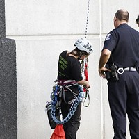 """Five members of Rainforest Action Network were arrested this morning after they dangled a banner off Bank of America stadium that read """"Bank of Coal."""""""