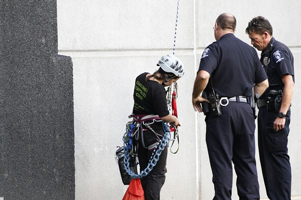 Five members of Rainforest Action Network were arrested this morning after they dangled a banner off Bank of America stadium that read Bank of Coal.