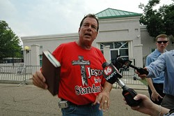 SUZI ALTMAN/ZUMA PRESS/NEWSCOM - FLIPPING OUT: Flip Benham in action — waving his Bible as a protest leader of Operation Save America in Jackson, Miss.