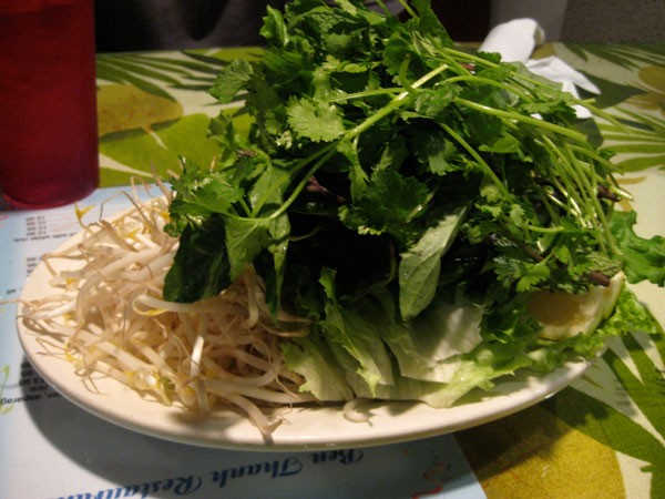 For the pho - A giant platter of bean sprouts, mint leaves, basil, lettuce and lemons to add to the bowl of pho we ordred.