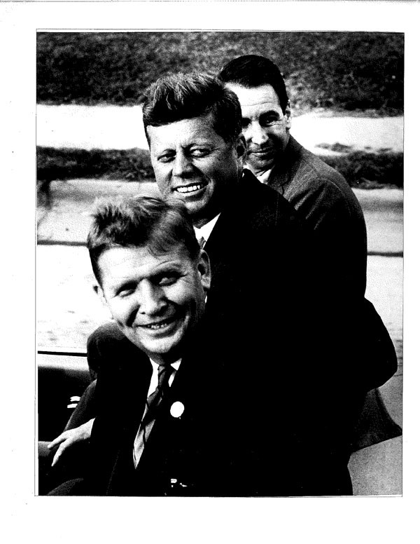 Former Tar Heel Gov. Terry Sanford, front, and state Congressman Nick Galifianakis host President John F. Kennedy during his visit to North Carolina in 1963. Sanford and Galifianakis represented a vibrant new era of state Democratic politics by embracing racial equality and economic progress. (Photo courtesy of the state Democratic Party)