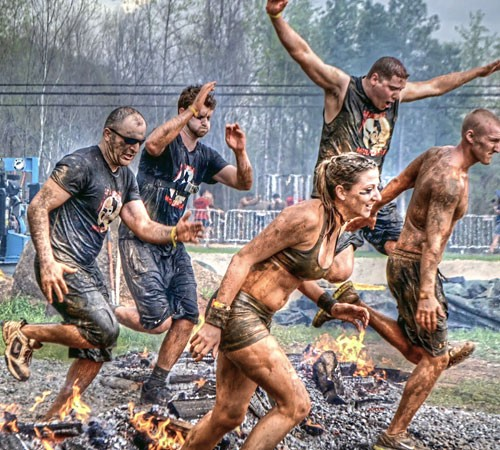 From left, Marco Ozdemir, Nick Mason, Nate Sallach and Jessica Nelso participate in a Spartan race. (Photo by Sam Brake)