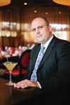General Manager Aaron Ward with a signature cocktail