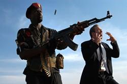 GARTH STEAD / LIONS GATE - GUN CRAZY Yuri (Nicolas Cage, right) goes ballistic in Lord of War
