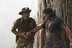 LIONSGATE - GUT REACTION: Rambo (Sylvester Stallone) sticks it to the enemy in Rambo.