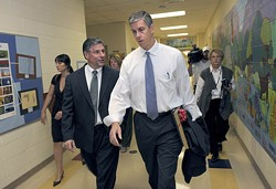 JOHN B. SIMMONS/MCT/NEWSCOM - HALL PASS: CMS Superintendent Peter Gorman, left, talks with Secretary of Education Arne Duncan after visiting Sterling Elementary School back in September 2010.
