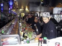 SAM BOYKIN - Hata Keyama and his fellow sushi chefs get rolling for RuSan's Thursday night dinner crowd.