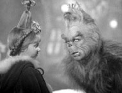 RON BATZDORFF/UNIVERSAL - HEAD WIG AND THE ANGRY GRINCH Buried under - Rick Baker's Oscar-winning makeup, Jim Carrey - (with Taylor Momsen) is a holiday hoot in  Dr. - Seuss' How the Grinch Stole Christmas