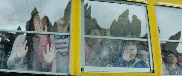 HEARD BUT NOT SEEN: Even the children wonder why Godzilla largely lacks Godzilla. (Photos: Warner Bros.)