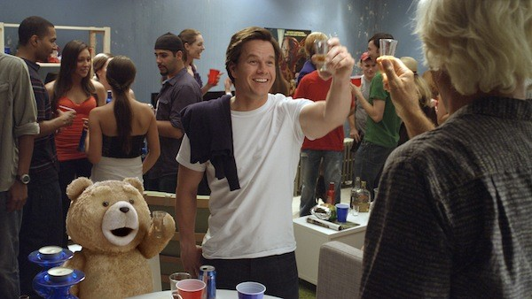 HE'LL OUTDRINK EVERY ONE OF US: Flash Gordon star Sam Jones (far right) does rum shots with Ted and John (Mark Wahlberg) in Ted. (Photo: Universal Pictures / Tippett Studio)