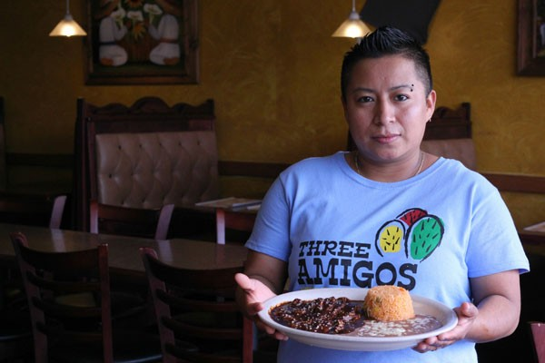 HOLY MOLE: Alejandra De la Cruz holds her signature dish.