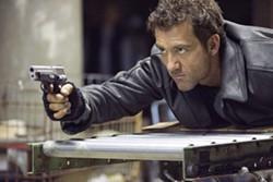 JAMES DITTIGER / NEW LINE - HOT SHOT: Clive Owen in Shoot 'Em Up