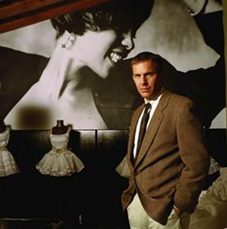 WARNER BROS. - HOUSTON, WE HAVE A PROBLEM: Whitney Houston (pictured in background) and Kevin Costner in The Bodyguard
