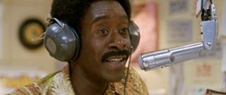 STEPHANE FONTAINE / FOCUS FEATURES - I LIKE MIC: Petey Greene (Don Cheadle) gets the word out in Talk To Me