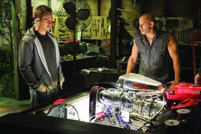 I WONDER HOW YOUR ENGINE FEELS: Brian O'Conner (Paul Walker, left) admires Dom Toretto's (Vin Diesel) hardware in Fast & Furious. (Photo: Universal)