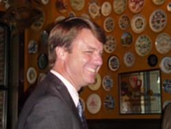 TIMOTHY C. DAVIS - If this is the Flying Saucer, how come the walls - are covered with plates? John Edwards smiles at his - observational prowess.
