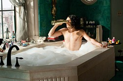 WARNER BROS. - IN THE DRINK: Arthur (Russell Brand) keeps busy.