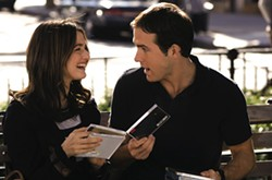 ANDREW SCHWARTZ / UNIVERSAL - INVESTING IN CDS: Summer (Rachel Weisz) and Will (Ryan Reynolds) share a laugh – and some tunes – in Definitely, Maybe.