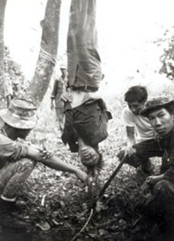 SEAN FLYNN - It was routine to interrogate Viet Cong suspects while - hanging them upside down; it wasn't routine to - photograph them in the process.