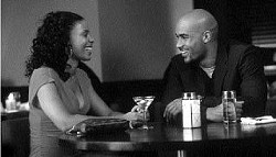 K.C. BAILEY/FOX SEARCHLIGHT - IT'S A DATE Sanaa Lathan enjoys a night out with new - beau Boris Kodjoe in Brown Sugar.