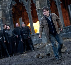 WARNER BROS. - IT'S ALL IN THE WRIST: Harry (Daniel Radcliffe) readies his wand for battle in Harry Potter and the Deathly Hallows - Part 2.