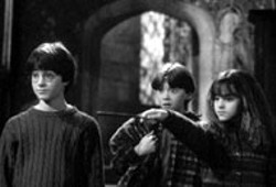 WARNER BROS - IT'S ALL IN THE WRIST Hermione (Emma Watson) - demonstrates her wand ways to Harry (Daniel - Radcliffe) and Ron (Rupert Grint) in Harry Potter - and the Sorcerer's Stone