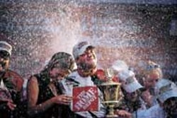 OLYA EVANITSKY - Jeff MacGregors wife and NASCAR tour partner Olya - Evanitsky took tons of photos during their trip, including - this one of Tony Stewart, in a rain of champagne, after - winning the NASCAR Winston Cup in 2002.