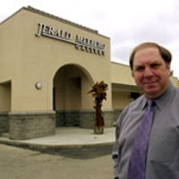 Jerald Melberg outside his new gallery location on      South Sharon Amity Road