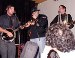John Popper onstage with the Avetts in NYC