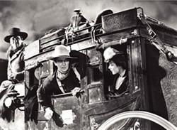 WARNER BROS. - John Wayne in Stagecoach.