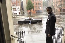 DAVID LEE / UNIVERSAL - KEEPING THE LAW AT BAY: Crime boss Frank Lucas (Denzel Washington) tries to maintain his distance from cop Richie Roberts (Russell Crowe) in American Gangster