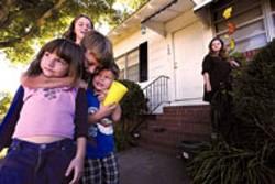 JIM STAWNIAK - Keri Alley, Shannon, Ga., with her children, Emma, - Eddie, Buddy and, in the rear, Fantasy