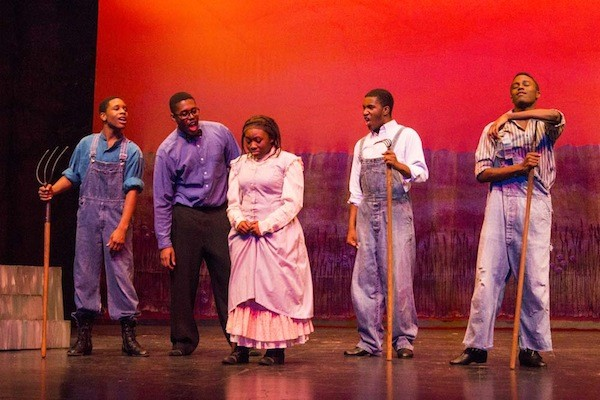 Keston Steele (center) as Celie in NWSAs production of The Color Purple