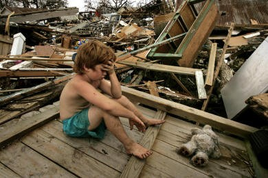 Kid in the post-Katrina ruins  (Photo courtesy Carolyn Cole)