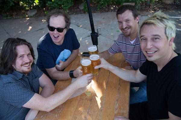 Knocking back a pint at Olde Mecklenburg Brewery with Temperance League: (from left) Eric Scott, Shawn Lynch, CL music editor Jeff Hahne and Bruce Hazel - SHANE CUDAHY