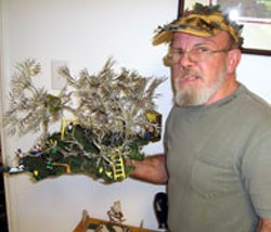 "SAM BOYKIN - Larry Heath, with his sculpture ""Backyard Friends"""