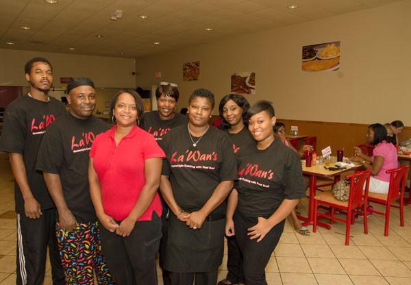 La'Wan Adams and her team  - JEAUMANE MCINTOSH