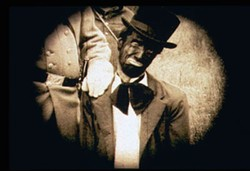 MATHEW JACOBSON / IFC FILMS - LINCOLN PARKED Disguised in blackface, Abraham Lincoln is apprehended as he tries to escape to Canada in a scene from CSA: Confederate States of America.