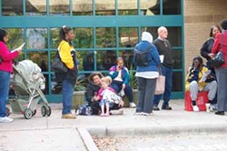 CHERIS HODGES - LINED UP: People wait to vote Monday morning