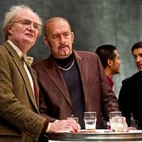 LITERARY DEVICE: Publisher Timothy Cavendish (Jim Broadbent) and his thuggish client Dermot Hoggins (Tom Hanks) attend a book event in Cloud Atlas. (Photo: Warner Bros.)