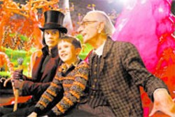 WARNER BROS - MAGICAL MYSTERY TOUR Willy Wonka (Johnny - Depp) offers Charlie (Freddie Highmore) and Grandpa - Joe (David Kelly) a factory guarantee in  - Charlie and the Chocolate Factory