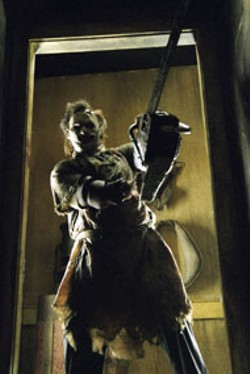 VAN REDIN/NEW LINE - MAKING AN ENTRANCE Leatherface  (Andrew - Bryniarski) comes calling in  The Texas Chainsaw - Massacre (2003)