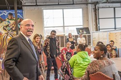 PHOTOS BY JUSTIN DRISCOLL - Mayor Dan Clodfelter tours Behailu Academy in early December.