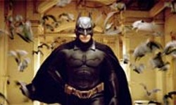 WARNER BROS - MEDIA STAR AND ENTOURAGE Batman Begins, - starring Christian Bale, marks a new chapter in the - Caped Crusader's celluloid saga