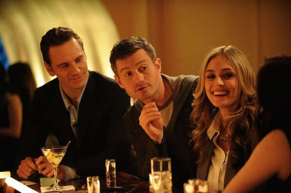Michael Fassbender (far left), James Badge Dale and Elizabeth Masucci in Shame (Fox)