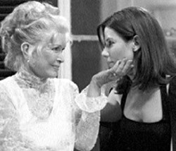WARNER & GAYLORD FILMS - MOMMIE FEAREST Sandra Bullock (right) is - wary of Ellen Burstyn in Divine Secrets of the - Ya-Ya Sisterhood
