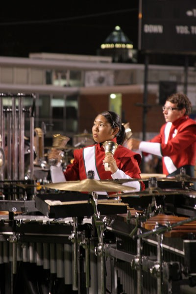 MORE COW BELL: Well, this member of the Santa Clara Vanguard may not actually be playing cow bells -- but, hey, those are bells. She was doing the ring thing at NightBEAT 2007 drum corps competition Sunday, July 15. - CATALINA KULCZAR